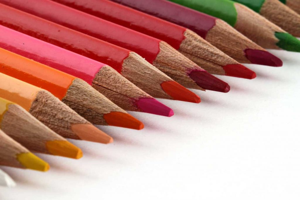 A row of colored pencils.
